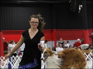 Loghan Burkey, 14, from Thornville, Ohio, shows her Borzoi named