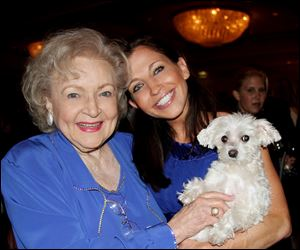 "Actresses Betty White, left and Wendy Diamond hold ""Lucky Diamond."" The fifteen-year-old Maltese who the Guinness Book of World Records credited was ""the animal photographed with the most famous people,"" died at her home in New York on Tuesday, June 5, 2012 of spleen cancer."