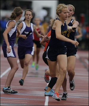 Toledo Christian's Krista Wood takes the baton from Darian Westmeyer. Along with Delainey Phelps and Michelle Wright, they won the 3200-meter relay at the Division III state meet in Columbus.