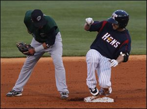 Charlotte's Tyler Kuhn makes a late tag on Ben Guez, who hit a double.