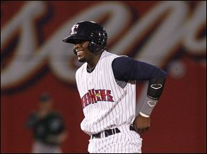 Toledo's Audy Ciriaco is all smiles after he hits a double in the ninth inning.
