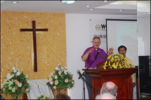 Bishop Bruce Ough addresses a congregation in Vietnam, where he aided in dedicating a new United Methodist center.
