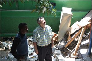 Bishop Bruce Ough walks through an earthquake-damaged building in Haiti.  The United Methodist Church's West Ohio Conference has forged ties in 'the four corners of the world.'