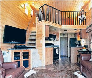 The interior of a Ventura Ranch Comfort Cabin at a KOA campground in Santa Paula, Calif., shows the range of options that have made sleeping in the great outdoors more comfortable than ever.