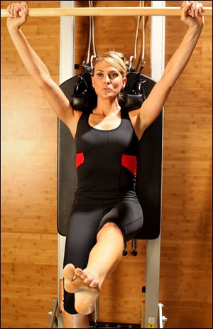 Andrea Robertson models fashionable workout wear. Studies have shown that dressing like a professional athlete can enhance performance.