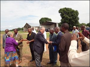 Bishop Bruce Ough visits the Democratic Republic of Congo. The 'miracle offering' at this year's meeting will go toward the $1.6 million cost of a refurbished plane to use in Congo's remote provinces.