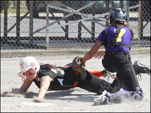 Summerfield player Brittni Collins is tagged out by Concord catcher Sydney Martines to end the third inning.