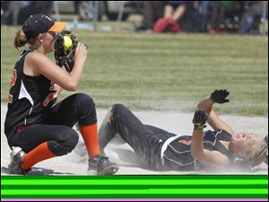 Summerfield player Olivia Ostrosky (32) puts a hard tag on a stealing Emily Wayer (7) of Hudson Area High School to end the 5th inning.