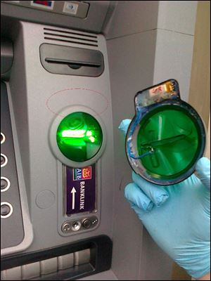 Some anti-skimming devices are blue or green semitransparent plastic casings that protrude from the card acceptance slots.