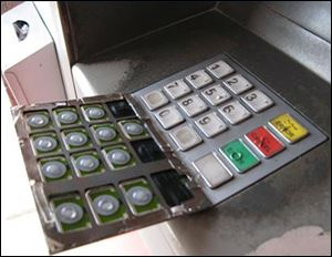 A PIN-capture overlay device pulls back to reveal the legitimate entry pad. At its most basic, a skimmer is a device that fits over the card slot of an ATM and reads the magnetic strip on the card. Some criminals place a tiny camera to record a customer entering data.