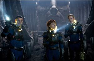 Logan Marshall-Green, left, Noomi Rapace, and Michael Fassbender, are shown in a scene from 'Prometheus.""