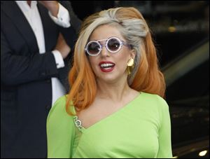 Lady Gaga arrives at the Sungshan airport in Taipei, Taiwan. Lady Gaga has been struck on the head by a pole while performing during the third of three shows in Auckland.