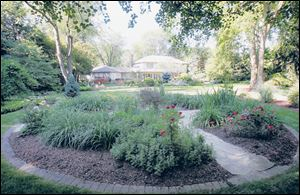 Gardens on the tour in West Toledo, like this one at the home of Bill and Sue Horvath, help raise funds for the Toledo Day Nursery.