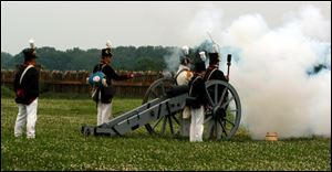 Re-enactors at Fort Meigs demonstrate how a cannon was fired during the War of 1812.
