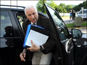 Former Penn State University assistant football coach Jerry Sandusky arrives for the fourth day of his trial at the Centre County Courthouse in Bellefonte, Pa.