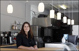 Kristin Kiser says Black Kite Coffee is a labor of love. The growth downtown is promising, she said, and the Old West End could benefit from similar development.