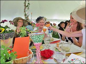 Lunching ladies enjoy the 9th annual Crosby Award Luncheon at the Toledo Botanical Garden.