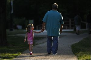 Kirk Baird and his daughter, Lainie spend time together at Wildwood Preserve Metropark.