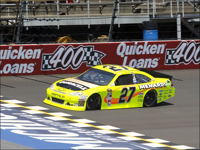 Patrick guns for victory Paul Menard takes his practice laps at Michigan International Speedway for Sunday's Quicken Loans 400 Sprint Cup race.