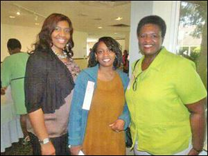 From left, Donnetta M. Carter, publicity chairman. Morgannia Dawson and Jacky Brown, global poverty chairman.