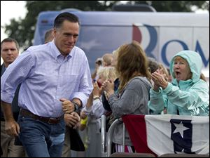Republican presidential candidate Mitt Romney arrives for a campaign stop at Mapleside Farms today in Brunswick, Ohio.