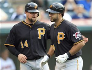 Pittsburgh's Casey McGehee, left, congratulates teammate Pedro Alvarez for hitting a two-run home run off Indians reliever Nick Hagadone in the ninth inning.