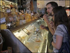 Katherine Fisher and Peter Shirts taste test goat cheese at Zingerman's Delicatessen.