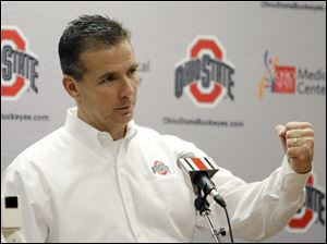 Football coach Urban Meyer has signed a six-year deal with Ohio State University.