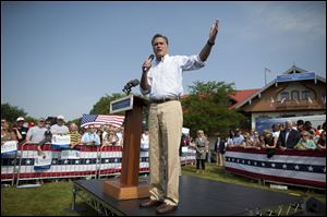 Republican presidential candidate, former Massachusetts Gov. Mitt Romney gestures during a campaign stop at Bavarian Inn Lodge in Frankenmuth, Mich.