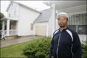Johnnie Barringer, who lives next to a boarded-up ONYX house on Tecumseh Street, says the blight has contributed to crime in the area. He has installed a security system and bars on his doors and windows.