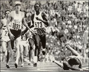 Dave Wottle, a Bowling Green graduate, wins the gold medal in the 800 final as the Soviet Union's Evgeny Arzhanov falls at the finish.