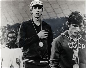 Dave Wottle got criticized for wearing his hat during the national anthem. He was so surprised to win, he forgot to take it off.