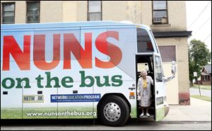 Sister Diane Donoghue steps down from the 'Nuns on the Bus' in Toledo. The group is visiting nine states to protest the U.S. budget pushed by Rep. Paul Ryan.