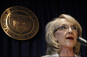 Arizona Gov. Jan Brewer speaks during a news conference about the United States Supreme Court decision regarding Arizona's controversial immigration law.