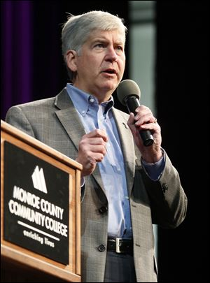 Michigan Governor Rick Snyder appears at a public hall town meeting at the Monroe County Community College La-Z-Boy Auditorium in Monroe, Mich.