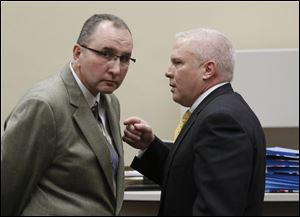 Robin Horvath, left, confers with lawyer Troy Moore following a hearing on the sale of Tony Packo's restaurants to Bob Bennett, in Lucas County Common Pleas Court in December 2011.