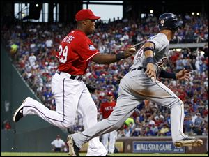 Texas Rangers third baseman Adrian Beltre (29) tags out Detroit Tigers