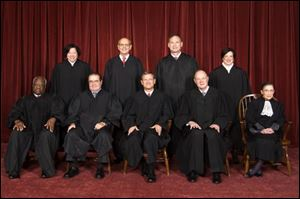 Supreme Court Justices from back left: Sonia Sotomayor, Stephen Breyer, Samuel Alito Jr., and Elena Kagan. Front from left: Clarence Thomas, Antonin Scalia, John Roberts (chief justice), Anthony M. Kennedy, and Ruth Bader Ginsburg. The court's four liberal justices, Stephen Breyer, Ruth Bader Ginsburg, Elena Kagan and Sonia Sotomayor, joined chief justice John Roberts in voting to uphold Obama's health care law. Justices Samuel Alito, Anthony Kennedy, Antonin Scalia and Clarence Thomas dissented.