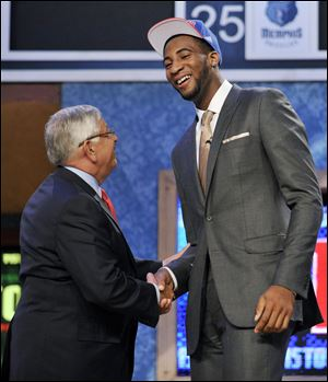 Andre Drummond shakes David Stern's hand after being picked by the Pistons. Detroit hoped he would slide down the draft board.