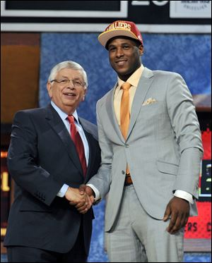 Dion Waiters stands with NBA commissioner David Stern after being picked by the Cavaliers with the fourth pick of Thursday's draft.