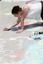 Mandy-Lehman-of-Toledo-competes-in-a-sidewalk-chalk-drawing