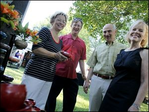 Susan and Keith Burwell, left, and Mark and Gretchen Zyndorf.