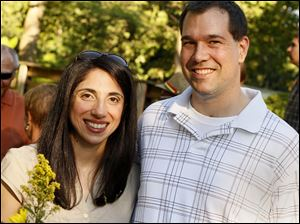 Maro and Mike McElheney, of Toledo, Ohio, pose for a picture at the Crosby Garden Preview Party in the Toledo Botanical Garden.