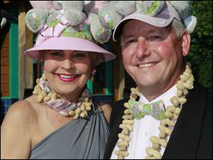 Kathleen and Douglas Andrews show off their hats and peanut jewelry at  ZOOtoDO at the Toledo Zoo.