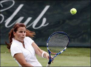 Ellie Clark returns a serve during  a tennis match. The matches on the grass courts were in honor of Wimbledon.