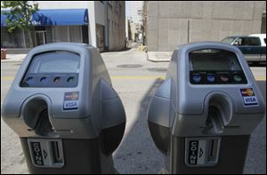 Parking meters that accept credit or debit cards are in use on two blocks of Madison Avenue, but the number is to expand to 400 by early fall.