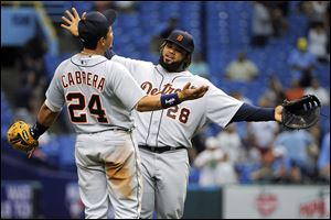 Detroit Tigers third baseman Miguel Cabrera, left, and first baseman Prince Fielder celebrate their 5-3 win over the Tampa Bay Rays following a baseball game, Sunday.
