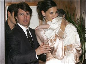 Tom Cruise, and U.S. actress Katie Holmes with their daughter Suri.
