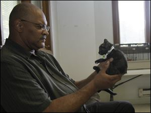 Toledoan Theodore Avery goes eye to eye with a kitten during the June $5 Fridays promotion of the Toledo Humane Society. He was looking for a companion for his 12-year-old cat, Tootee.