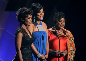 From left, Angela Bassett, Lela Rochon, and Loretta Devine speak during the memorial for Whitney Houston at the BET Awards.